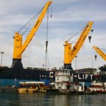 Immense cranes are ready to unload the Tunnel Boring Machine from the ship's hold in Miami