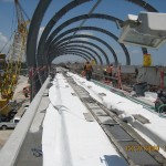 Standing on the Guideway - view from Station Platform - NOTE: Curved metal roof canopy framework